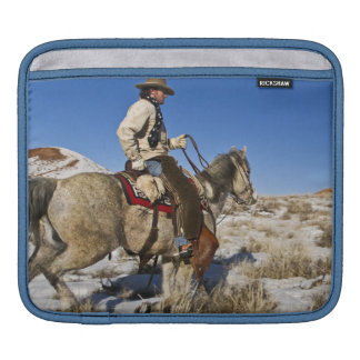Cowboy with horses on the range on The Hideout Sleeve For iPads