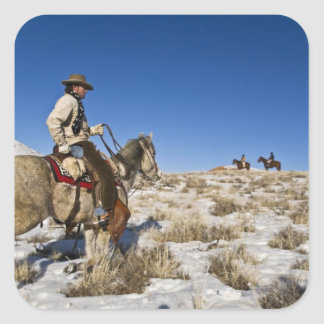 Cowboy with horses on the range on The Hideout Sticker
