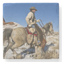 Cowboy with horses on the range on The Hideout Stone Coaster