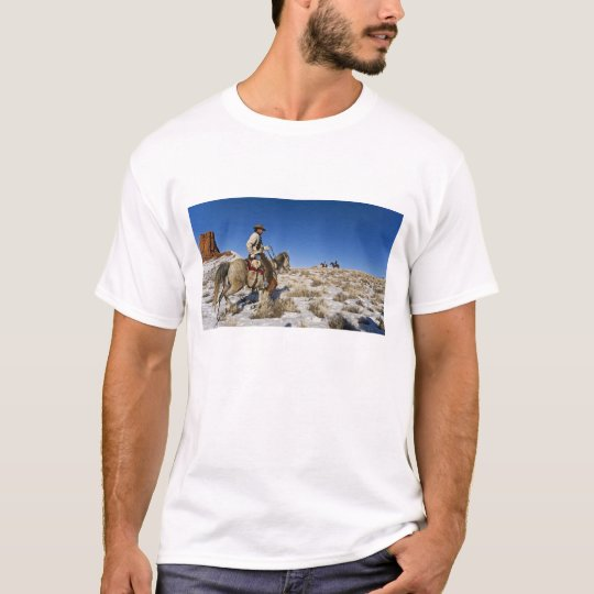 Cowboy with horses on the range on The Hideout T-Shirt