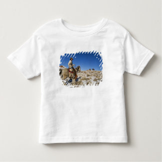 Cowboy with horses on the range on The Hideout Toddler T-shirt