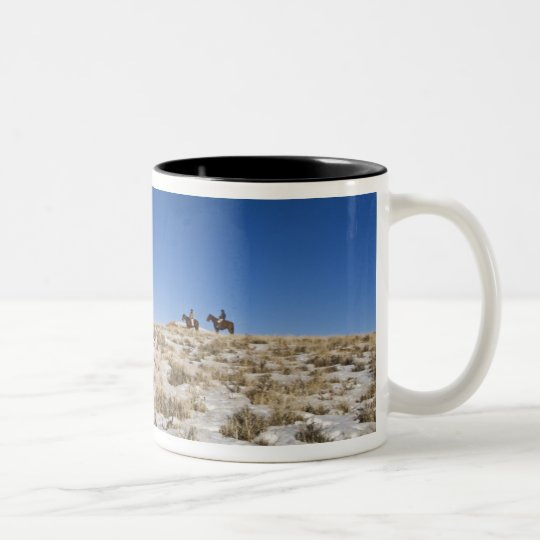 Cowboy with horses on the range on The Hideout Two-Tone Coffee Mug
