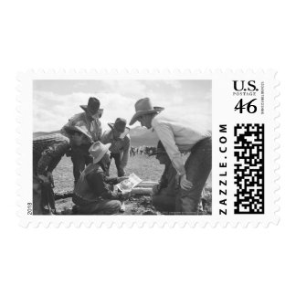 Cowboys looking a magazine postage