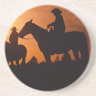 cowboys on horses at sunset Sandstone Coaster