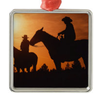 cowboys on horses Christmas ornament