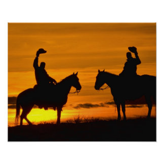 Cowboys on ridge at Sunset Poster
