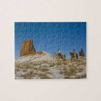 Cowboys on Ridge riding Horse through the Snow Jigsaw Puzzle