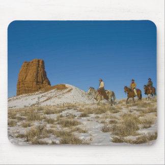 Cowboys on Ridge riding Horse through the Snow Mouse Pad