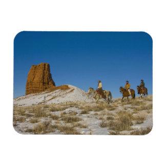 Cowboys on Ridge riding Horse through the Snow Flexible Magnets