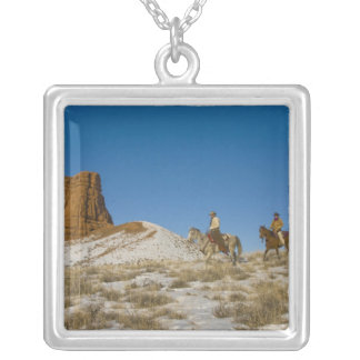 Cowboys on Ridge riding Horse through the Snow Silver Plated Necklace