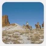 Cowboys on Ridge riding Horse through the Snow Square Stickers