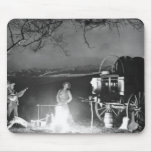 Cowboys playing and singing around a campfire mouse pad