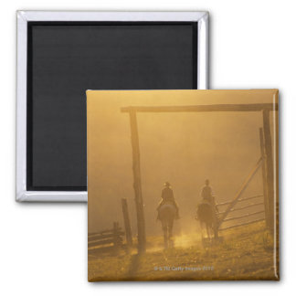 Cowboys riding through gate at dusk 2 inch square magnet