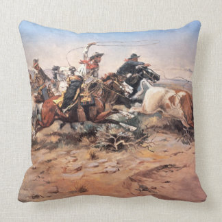 Cowboys roping a steer, 1897 (oil on canvas) throw pillow