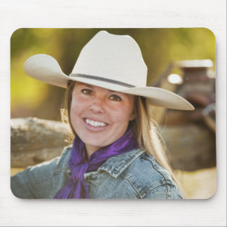 Cowgirl beside fence mouse pad