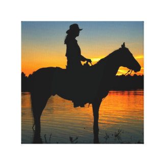 Cowgirl in Sunset Stretched Canvas Print