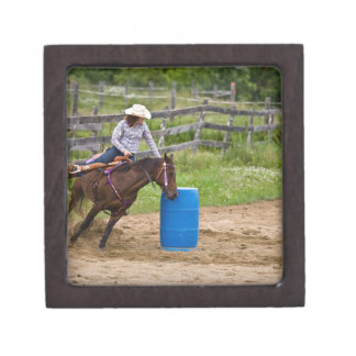 Cowgirl on horseback practicing barrel racing in premium gift boxes