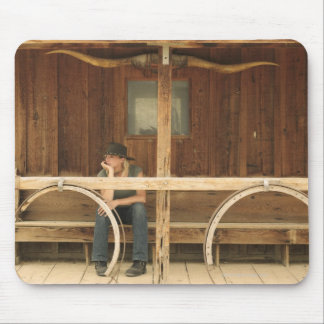 Cowgirl sitting on ranch porch mouse pad