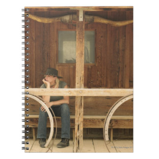 Cowgirl sitting on ranch porch notebook