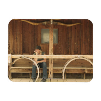 Cowgirl sitting on ranch porch magnets