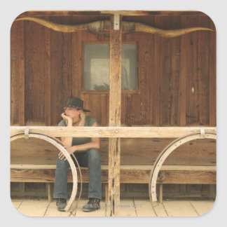 Cowgirl sitting on ranch porch square sticker