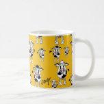 Cows and bulls pattern on yellow background. mug