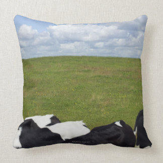 Cows in a pasture throw pillow