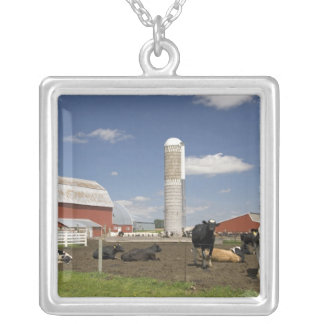 Cows in front of a red barn and silo on a farm square pendant necklace