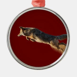 coyote jumping metal ornament