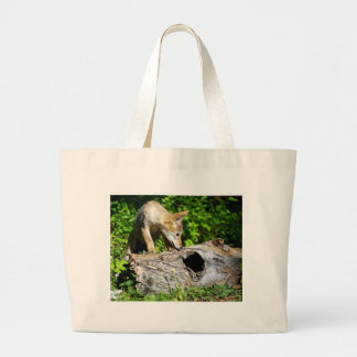 Coyote Pup - What is in that Log? Large Tote Bag