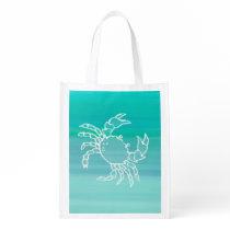 Crab in aquamarine colored ocean grocery bag