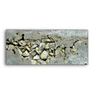 Cracked concrete wall with small stones envelope