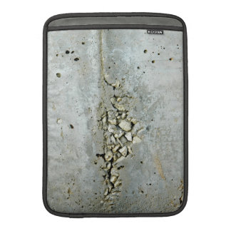 Cracked concrete wall with small stones MacBook sleeve