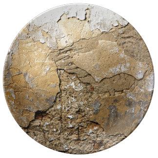 Cracked plastered wall. dinner plate