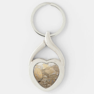 Cracked plastered wall. keychain