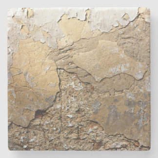 Cracked plastered wall. stone coaster