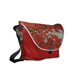 Cracked red concrete wall textured background bag courier bag