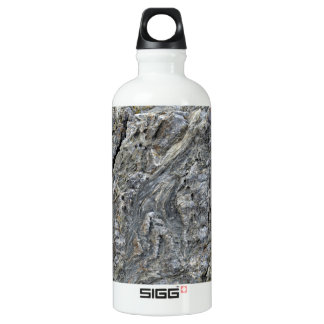 Cracked rock surface with irregular patterns water bottle