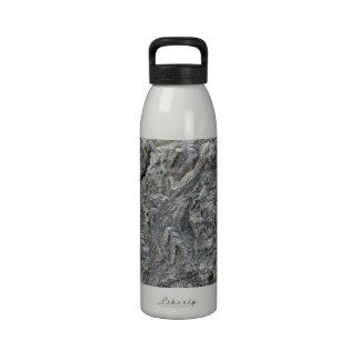 Cracked rock surface with irregular patterns water bottles