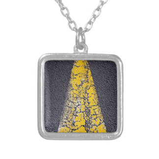 Cracked yellow arrow on a road silver plated necklace