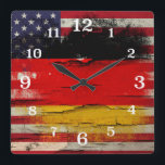 "Crackle Paint | German American Flag Square Wall Clock<br><div class=""desc"">Cool square wall clock for someone with a German American heritage! A faded and worn American flag blended with the German flag and placed over a rustic piece of wood with paint starting to peel off.</div>"