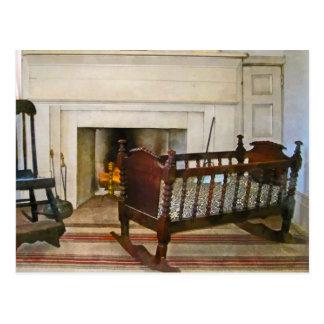 Cradle Near Fireplace Postcard