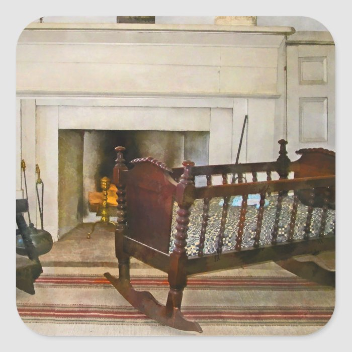Cradle Near Fireplace Square Sticker