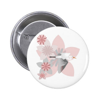 Crane and flower button