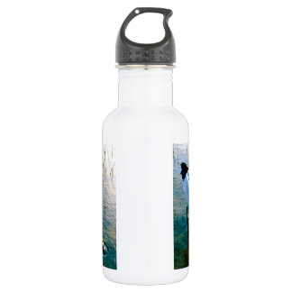 Crane feeding in shallow water water bottle
