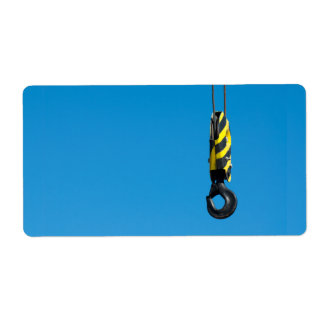 Crane hook with yellow and black stripes hanging label