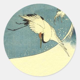 Crane In Ocean Wave Classic Round Sticker
