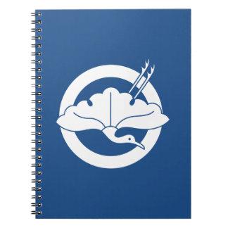 Crane-shaped ginkgo leaf on circle spiral notebook