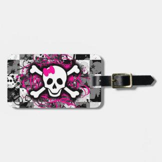 Cráneo a cuadros con la salpicadura de las rosas f etiquetas maleta