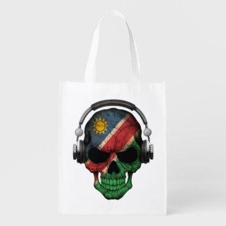 Cráneo adaptable de namibiano DJ con los Bolsa De La Compra